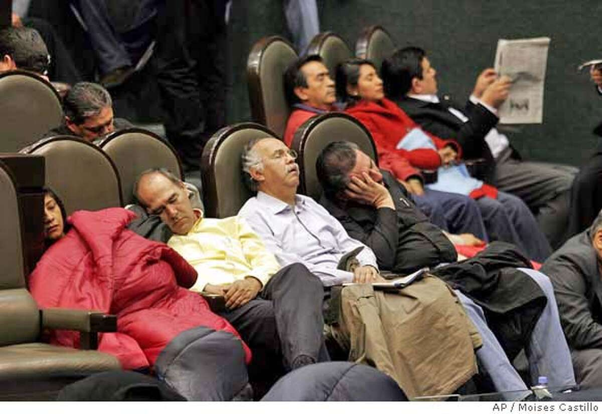 Congressional lawmakers sleep at Congress Hall, in Mexico City, Mexico, Thursday, Nov. 30, 2006, just days before President-elect Felipe Calderon is to be named president. Ruling party lawmakers on Wednesday sought an end to their unruly standoff with leftist legislators in the congressional chambers where in two days President-elect Felipe Calderon is due to be sworn in before foreign dignitaries including former U.S. President George H.W. Bush. (AP Photo/Moises Castillo) **EFE OUT**