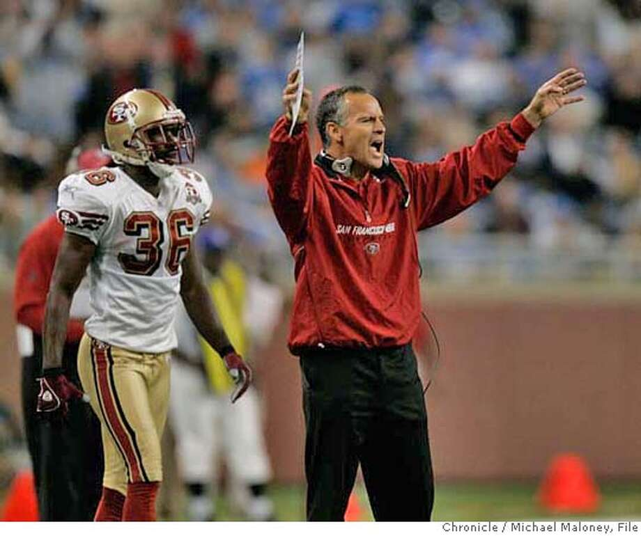 Head coach Mike Nolan tries to get the attention of his players in the 4th quarter. #36 is Shawntae Spencer.  San Francisco 49ers vs the Detroit Lions at Ford Field in Detroit Michigan. 49ers won 19-13.  Photo by Michael Maloney / San Francisco Chronicle on 11/12/06 in Detroit,MI *** MANDATORY CREDIT FOR PHOTOG AND SF CHRONICLE/ -MAGS OUT Photo: Michael Maloney
