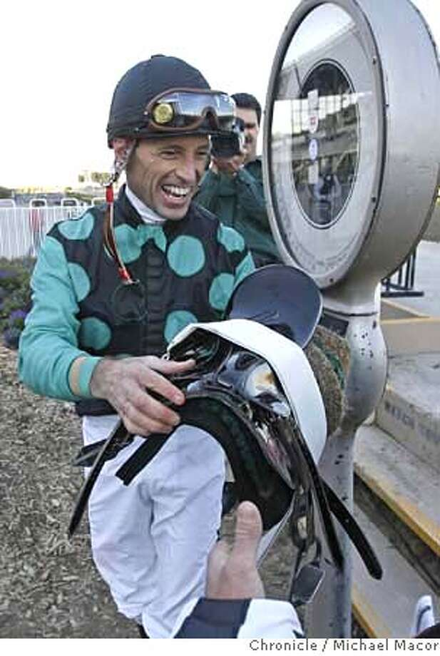 "baze_0509_mac.jpg Baze all smiles after winning the 6th, weighing in following the historic win. Jockey, Russell Baze tied the all time record for most wins today, of 9,530 set by Lafit Pincay Jr., riding ""Christie's Fame"" in the 6th race at Bay Meadows Race Track in San Mateo. Event in, San Mateo, Ca, on 11/30/06. Photo by: Michael Macor/ San Francisco Chronicle Mandatory credit for Photographer and San Francisco Chronicle / Magazines Out Photo: Michael Macor"