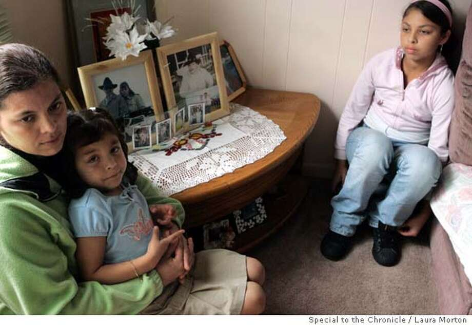 Irma Coria with her 4-year-old daughter Leslie Coria and 12-year-old Evelyn Coria in front of a table in their Moss Beach, CA home where Coria keeps photographs of her husband who passed away in August from leukemia. Coria needs money to help sustain her family until she can find employment. Ran on: 12-01-2006  Irma Coria now has to raise her children, 4-year-old Leslie and 12-year-old Evelyn, alone after the unexpected death of her husband in August from leukemia. Her third daughter is not pictured.  Ran on: 12-01-2006 Ran on: 12-01-2006 Ran on: 12-01-2006 Photo: Laura Morton