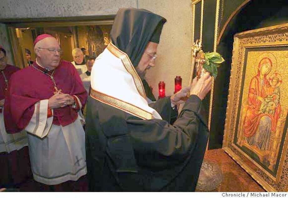 bishop30_0078_mac.jpg Niederaur, (left) and Gerasimos join together in the blessing of the mosaic. San Francisco's highest ranking Greek Orthodox leader (Metropolitan Gerasimos) and its highest-ranking Catholic leader (Archbishop George Niederauer) comemorate the Pope's visit to the Ecumenical Patriarchate of Constantinople Wednesday by visiting with each other. The gathering also celebrates the donation by Ginnie and Leo Koulos of the �Madonna In Trono� mosaic & shrine. Event in, San Francisco, Mo, on 11/29/06. Photo by: Michael Macor/ San Francisco Chronicle Mandatory credit for Photographer and San Francisco Chronicle / Magazines Out Photo: Michael Macor