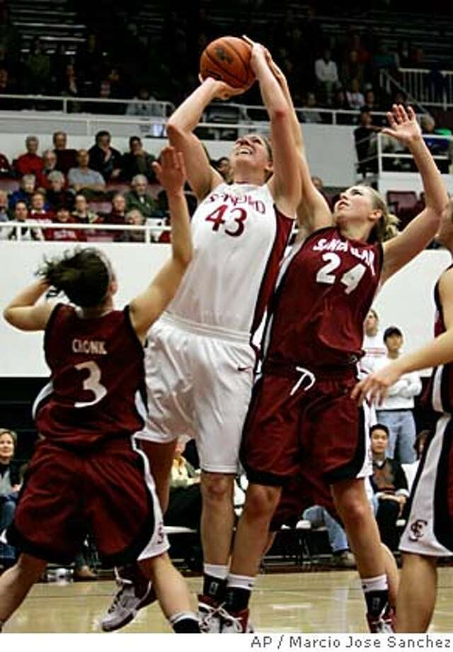 Stanford's Kristen Newlin (43) shoots while defended by Santa Clara's Chandice Cronk (3) and Kasey Monteith (24) in the first half of a basketball game in Stanford, Calif., Wednesday, Nov. 29, 2006.(AP Photo/Marcio Jose Sanchez) Photo: MARCIO JOSE SANCHEZ