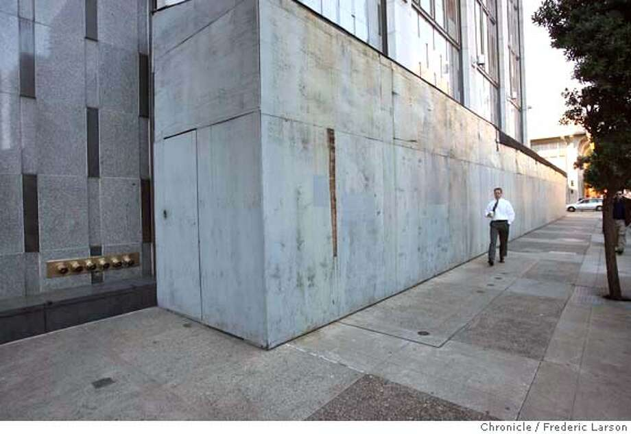Since 2001, the Turk Street side of the Phillip Burton Federal Building and U.S. Courthouse has been scarred by plywood enclosures that block the sidewalk. The structures were installed in anticipation of construction work on the facade and air conditioning systems that has still not happened for various funding related reasons, according to the federal General Services Administration, which manages the building. Bids were solicited in spring of this year, but all came in between $3 million and $4 million, in excess of the $2.41 million threshold beyond which Congressional authorization is required. The GSA is now preparing to submit the project to Congress to get that authority. The GSA will then solicit new bids for the work, which is estimated to take seven months, making completion possible by the end of 2008. 11/30/06  {Photographed by Frederic Larson} MANDATORY CREDIT FOR PHOTOGRAPHER AND SAN FRANCISCO CHRONICLE/ -MAGS OUT Photo: Frederic Larson