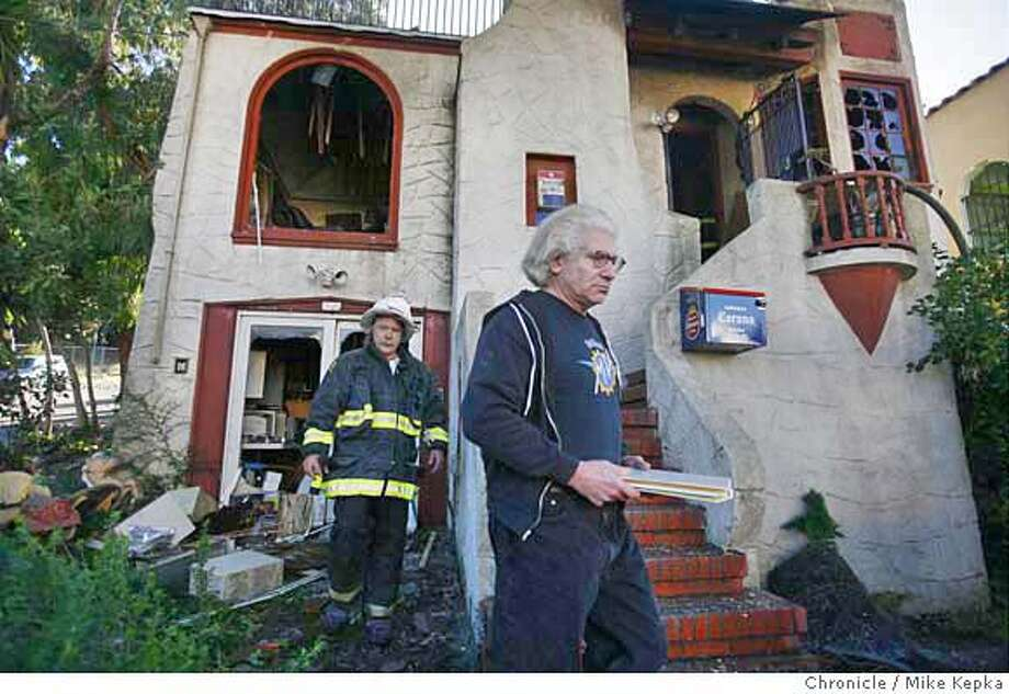 "fire3000339_mk.JPG Don Bertone, San Francisco's ""nightmare neighbor,"" goes through his smoldering house with SFFD after it caught fire around noon on Wednesday, November 30, 2006 Mike Kepka / The Chronicle Don Bertone (cq) the source MANDATORY CREDIT FOR PHOTOG AND SF CHRONICLE/ -MAGS OUT Photo: Mike Kepka"