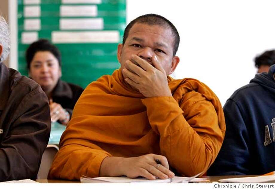 speakers29_0118_cs.jpg  Thai monk Tongsumut Vorasan ponders a study problem on the dry board in Betsy St. Aubin�s adult English language class at Berkeley Adult School, 1701 San Pablo Avenue, November 28, 2006.  Chris Stewart / The Chronicle Berkeley Adult School, English language, census MANDATORY CREDIT FOR PHOTOG AND SF CHRONICLE/ -MAGS OUT Photo: Chris Stewart