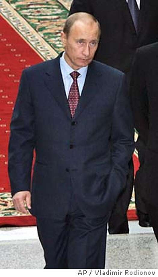 ** RECROP OF MOSB104 ** Russian President Vladimir Putin, left, Ukrainian President Viktor Yuschenko, right, Belarus President Alexander Lukashenko, background left, Uzbekistan's President Islam Karimov, background right, walk before the meeting in Minsk, Belarus, Tuesday, Nov. 28, 2006. The heads of 11 former Soviet republics on Tuesday opened a summit of the Commonwealth of Independent States expected to focus on reforming the 15-year-old organization. Kazakh President Nursultan Nazarbayev, whose oil-rich Central Asian nation holds the group's rotating presidency, said in July that the CIS should concentrate on economic ties. Russia's Nezavisimaya Gazeta said Tuesday that Nazarbayev backed transforming the CIS into a free-trade zone like the European Union. (AP Photo/ Vladimir Rodionov/ , Presidential Press Service ) Photo: VLADIMIR RODIONOV