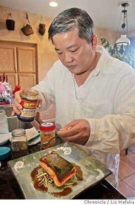 CHEF29_DUONG_LH_020.JPG Ana Mandara chef Khai Duong at his home, preparing crispy-skinned salmon. Photographed by Liz Hafalia MANDATORY CREDIT FOR PHOTOGRAPHER AND SAN FRANCISCO CHRONICLE/ -MAGS OUT
