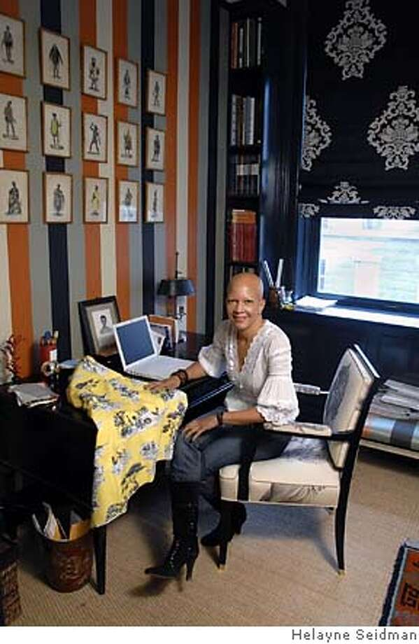 Designer Sheila Bridges in her Harlem home. She's known for designing former President Clinton's Harlem offices. Now she has designed an African American version of traditional toile. Photo by Helayne Seidman