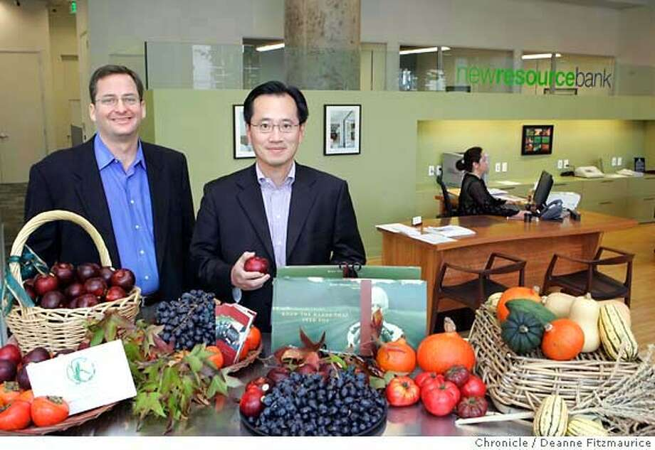 greenbank_0011_df.jpg  (l to r) Clay Jones, President and CEO, and Peter Liu, Vice Chairman, of New Resource Bank are photographed in front of a display of fruits and vegetables from Marin Organic and Veritable Vegetable which are two companies New Resource Bank does business with. Photographed in San Francisco on 11/16/06. (Deanne Fitzmaurice/ The Chronicle) Mandatory credit for photographer and San Francisco Chronicle. /Magazines out. Photo: Deanne Fitzmaurice