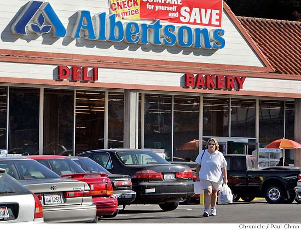 grocery_009_pc.jpg A shopper carries bags of groceries from the Albertsons grocery store on Lakeshore Avenue on 10/5/05 in Oakland, Calif. Albertsons announced this month that it may put the company up for sale, while 20 Ralphs, Bell and Cala stores are on the block in SF and the North Bay. Big chains like Albertsons are being squeezed by Walmart on one side and upscale grocers like Whole Foods on the other. PAUL CHINN/The Chronicle MANDATORY CREDIT FOR PHOTOG AND S.F. CHRONICLE/ - MAGS OUT