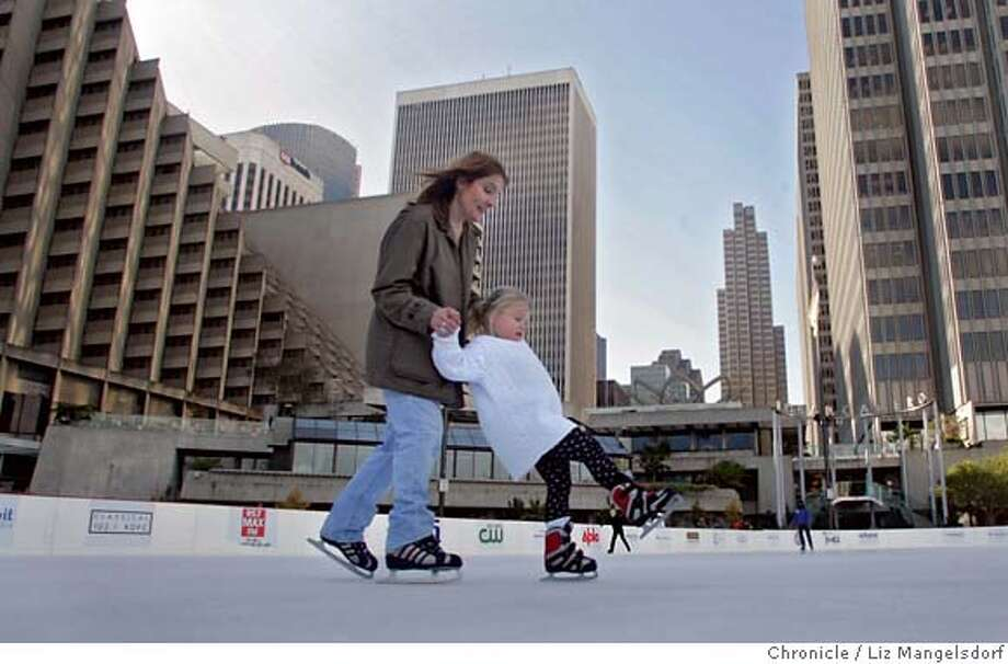 Karina Cutrona, 4, is helped around the ice by her mother Chris Cutrona a the Holiday Ice Rink at Embarcadero Center on Monday Nov. 27, 2006 in San Francisco. they are from Buffalo New York, but this was Karina's first time on the ice. The ice rink, at Justin Herman Plaza, is open daily until January 2nd, 2007.  Liz Mangelsdorf / The Chronicle MANDATORY CREDIT FOR PHOTOG AND SF CHRONICLE/ -MAGS OUT Photo: Liz Mangelsdorf