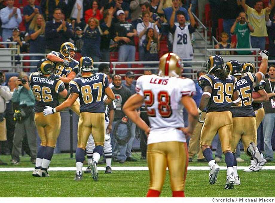 49er 28-Keith Lewis can only watch as the Rams celebrate the go-ahead touchdown by 83- Kevin Curtis with 29 seconds left in the game. Rams win the game 20-17. San Francisco 49ers vs. St. Louis Rams. Event in, St. Louis, Mo, on 11/26/06. Photo by: Michael Macor/ San Francisco Chronicle Photo: Michael Macor
