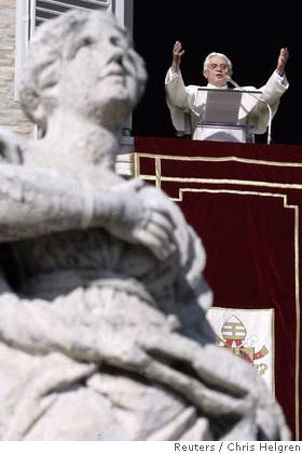 Pope Benedict XVI holds his weekly Angelus blessing from a window of his private apartments overlooking St. Peter's Square at the Vatican November 26, 2006. Pope Benedict will visit Istanbul's famous Blue Mosque on his trip to Turkey next week, the Vatican said on Sunday. REUTERS/Chris Helgren (VATICAN)
