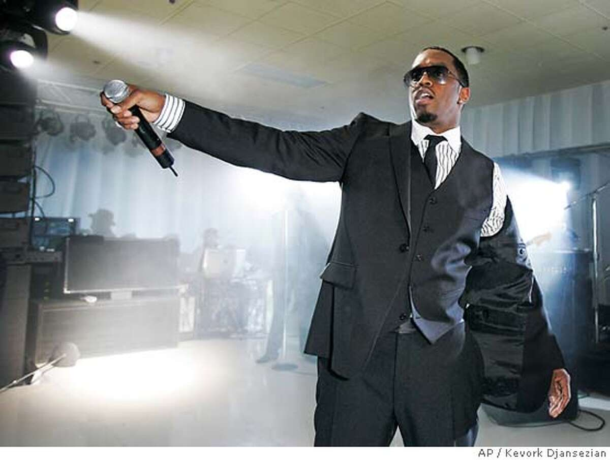 Singer Diddy performs a song from his new album at a party held by Sony Computer Entertainment America to celebrate the new Playstation 3 game console in Beverly Hills, Calif., Wednesday Nov. 8, 2006. The Playstation 3 game console will be released in U.S. on Friday Nov.17. (AP Photo/Kevork Djansezian)
