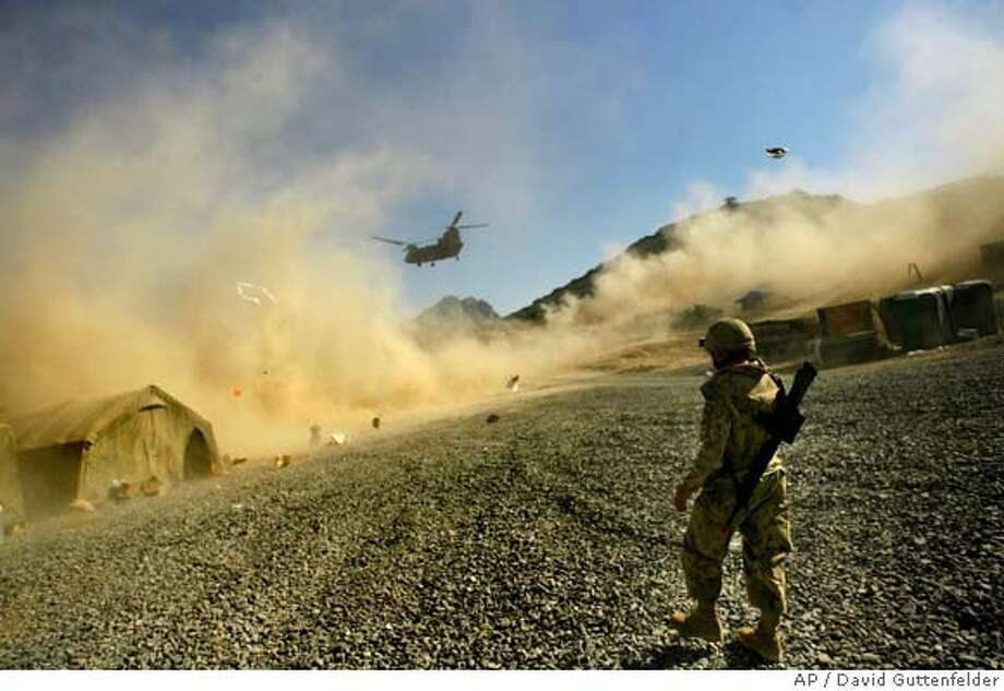 A coalition helicopter arrives at the Mas'um Ghar base to ferry soldiers into the Kandahar province of Afghanistan Sunday Nov. 26, 2006. (AP Photo/David Guttenfelder) Photo: DAVID GUTTENFELDER