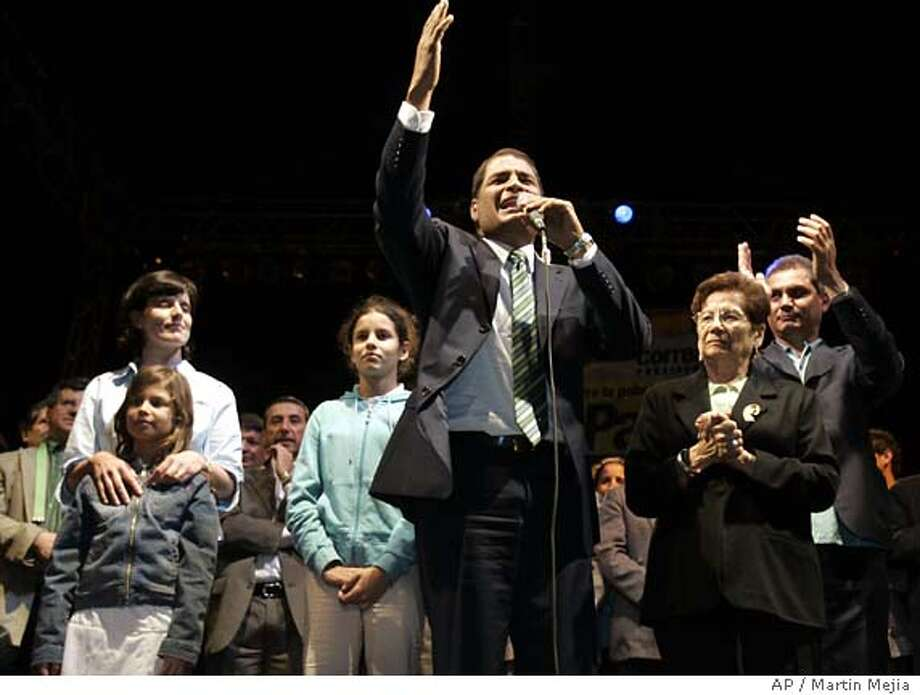 Rafael Correa speaks to his supporters together with his family on stage after exit polls show he has won election as the new president of Ecuador, according to exit polls, in Quito, Ecuador, Sunday, Nov. 26, 2006. (AP Photo/Martin Mejia) Photo: MARTIN MEJIA