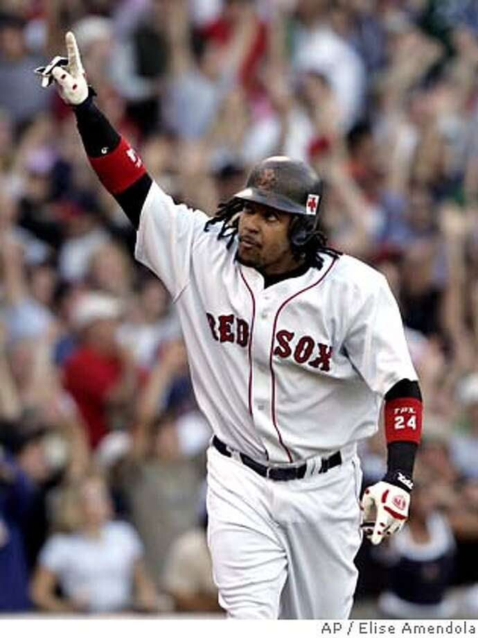 Boston Red Sox' Manny Ramirez rounds the bases after his three-run home run off New York Yankees pitcher Scott Proctor during the fourth inning at Fenway Park in Boston, Sunday, Oct. 2, 2005. At left is Yankees catcher Jorge Posada.(AP Photo/Elise Amendola) Ran on: 10-03-2005  Manny Ramirez rounds the bases after his three-run homer in a rout of the Yankees. Photo: ELISE AMENDOLA