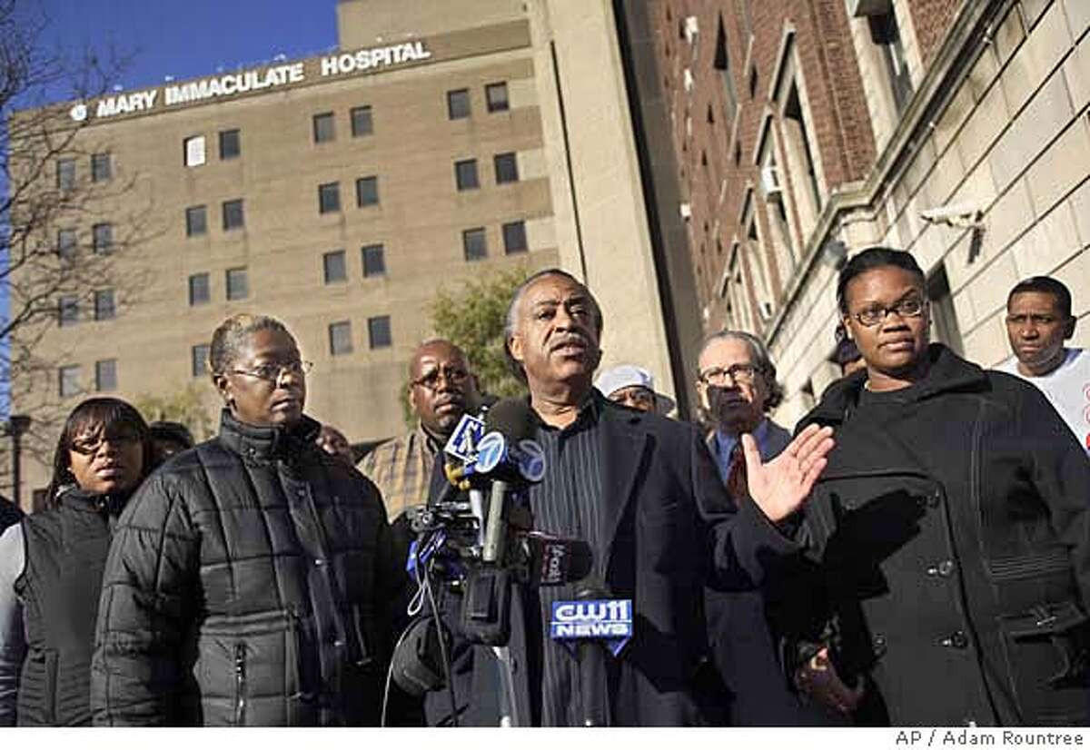 Rev. Al Sharpton speaks to the media as family members of the victims of a police shooting, Denise Ford,second left, the mother of Trent Benefeld, and Ebony Guzman, right, the wife of Joseph Guzman, look on during a press conference outside of Mary Immaculate Hospital in the Queens borough of New York on Saturday, Nov. 25, 2006. Trent Benefeld, 23, Joseph Guzman, 31, and Sean Bell, 23, who were attending a bachelor party at the club were shot by police officers just after leaving on early Saturday morning. Benefeld and Guzman were hospitalized and Bell, the groom, died from his gunshot wounds. (AP Photo/Adam Rountree)