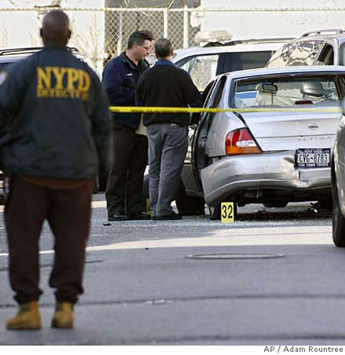 New York Police Depatment crime scene investigators inspect a vehicle involved in a police shooting that took place near the Kalua Cabaret, in the Jamaica section of Queens, N.Y., Saturday, Nov. 25, 2006. A bachelor party at the Queens strip club ended in tragedy Saturday morning after police officers opened fire on a group of men leaving the establishment _ killing a groom on his wedding day and leaving two other men injured. (AP Photo/Adam Rountree)