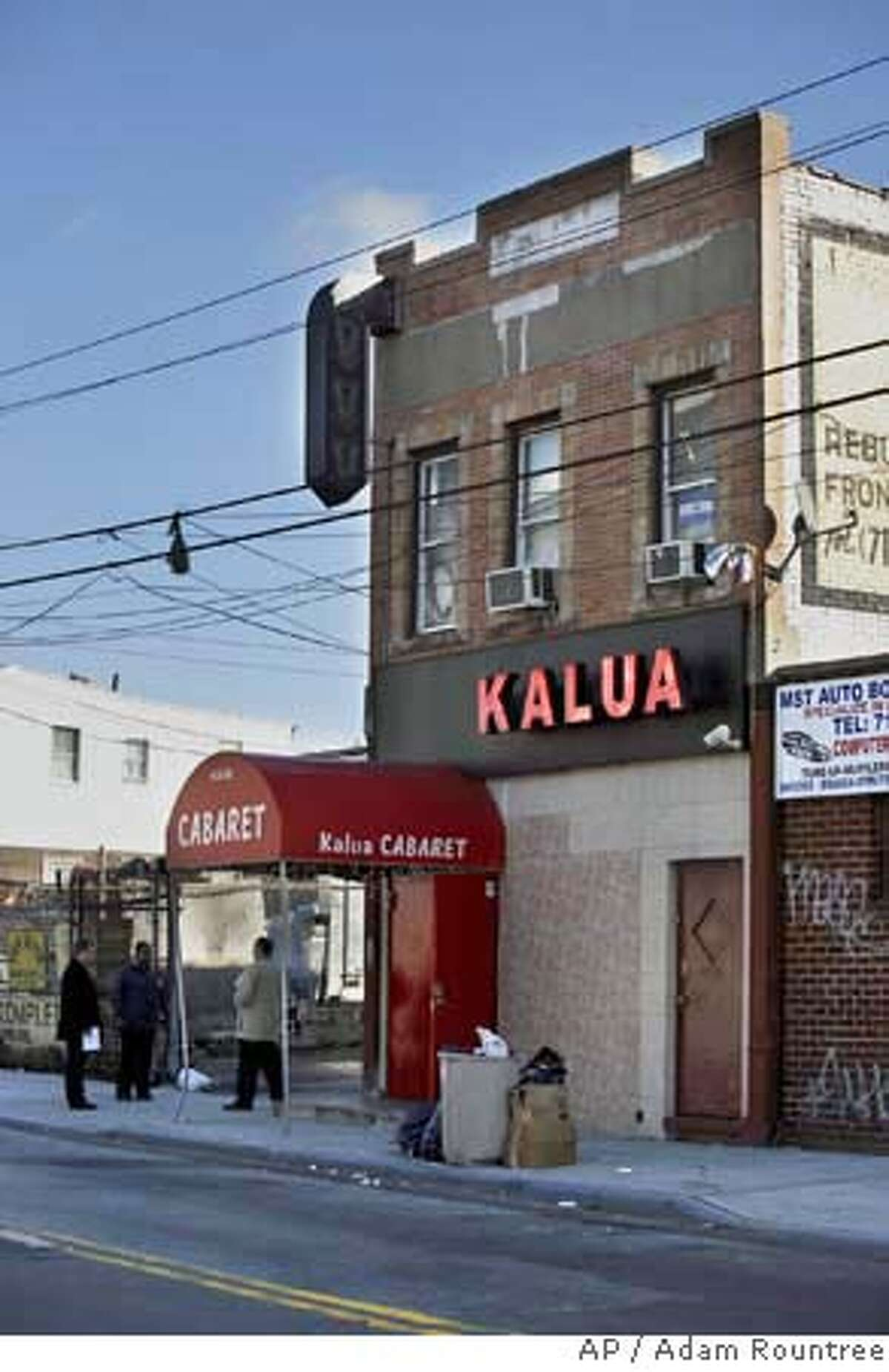 Police detectives are seen outside of Kalua Cabaret, a strip club in the Queens borough of New York on Saturday, Nov. 25, 2006. Trent Benefeld, 23, Joseph Guzman, 31, and Sean Bell, 23, who were attending a bachelor party at the club were shot by police officers just after leaving on early Saturday morning. Benefeld and Guzman were hospitalized and Bell, the groom, died from his gunshot wounds. (AP Photo/Adam Rountree)
