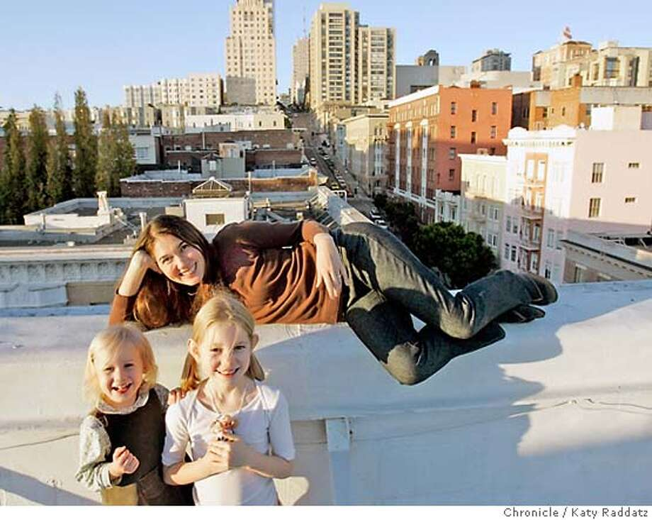 LANDLORDS26_075_RAD.jpg  SHOWN: Tina Warren and her two daughters, Lucie, age 2, and Isabel, age 6, on the roof of their building at 801 Sutter. The best thing, Tina says, about this duplex apartment is the roof access. Tina and her husband, Ben, and their family have lived in the two-bedroom duplex at the top of 801 Sutter for four years, and Tina has lived in the building since 1989! Story is about how at least one landlord in SF is not going to raise rents in the building at 801 Sutter St.---Matthew Hallinan, manager of the ValeyHallinan Properties believes in building communities foremost, and is determined to keep his rents low. These pictures were made on Tuesay, Nov. 21, 2006, in San Francisco, CA.  (Katy Raddatz/SF Chronicle)  *Matthew Hallinan, Tina Warren, Isabel Warren, Lucie Warren Mandatory credit for the photographer and the San Francisco Chronicle. ; mags out. Photo: Katy Raddatz