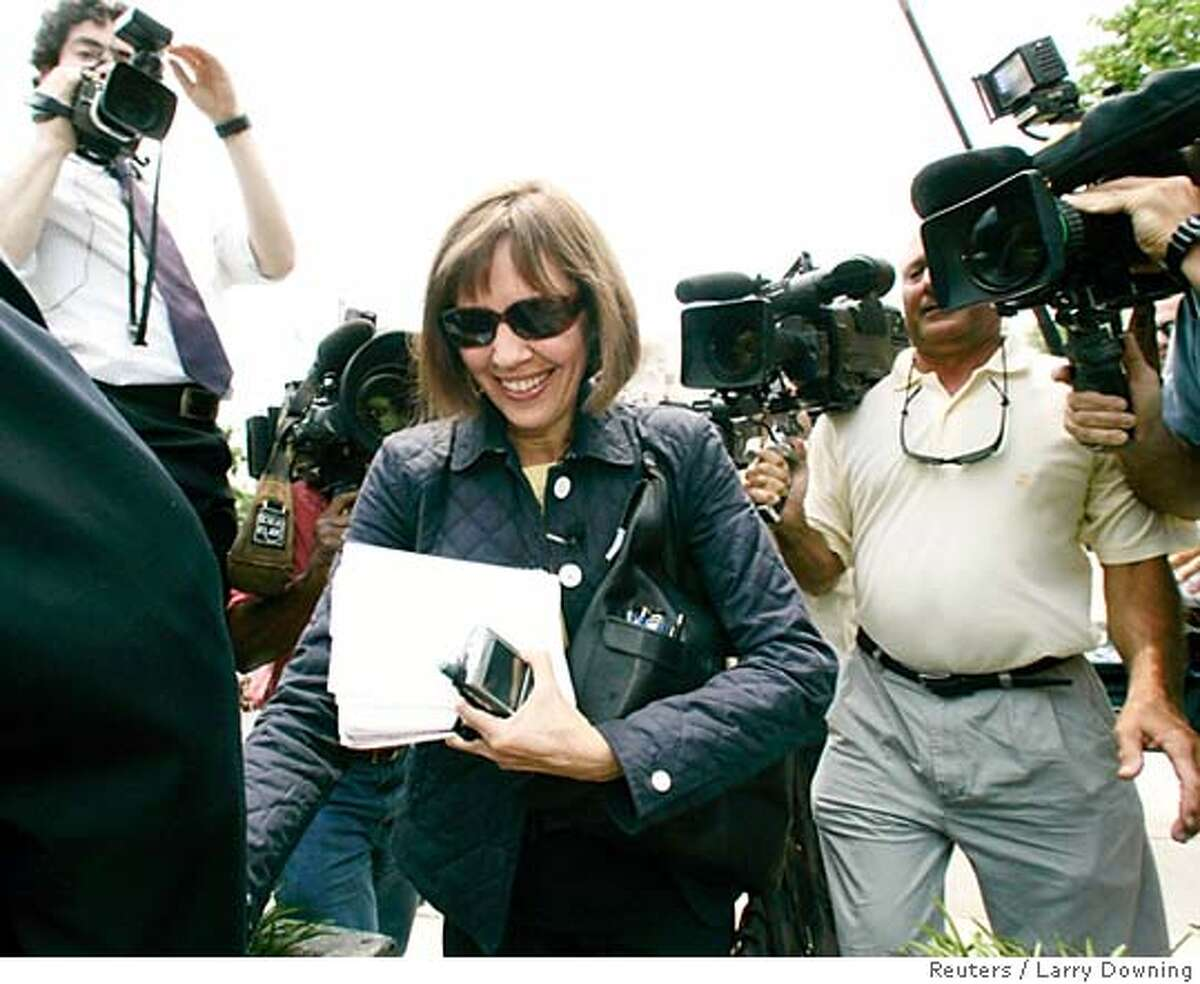 New York Times reporter Judith Miller walks towards U.S. federal district court in Washington, July 6, 2005, for a scheduled hearing on her refusal to provide the identity of her confidential sources to a prosecutor investigating the Bush administration's leak of a CIA officer's identity. Miller was jailed on Wednesday after she said she could not break her promise and reveal her confidential source to a grand jury investigating the leak of a covert CIA operative's name to the media. REUTERS/Larry Downing Ran on: 07-17-2005 use group caption 0