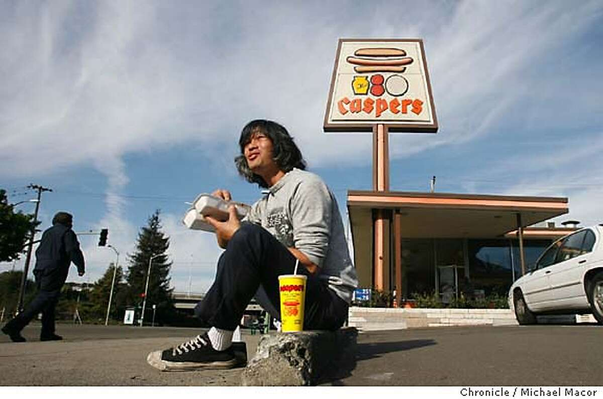 onthetown_quan_059_mac.jpg Russell Quan, (cq), local garage rock icon enjoys lunch at Casper's Hot Dogs in Oakland. Event in, Oakland, Ca, on 11/15/06. Photo by: Michael Macor/ San Francisco Chronicle Mandatory credit for Photographer and San Francisco Chronicle / Magazines Out