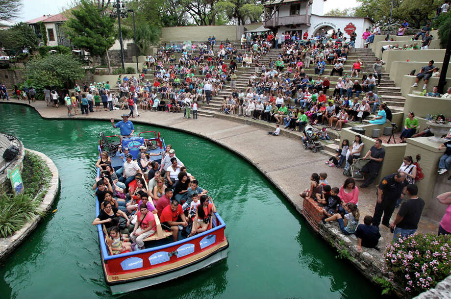 Waters of the San Antonio River turn green before the start of St. Patrick's Day festivities at Arneson River Theatre on  March 16, 2012 Photo: TOM REEL, Tom Reel / Treel@express-news.net / San Antonio Express-News