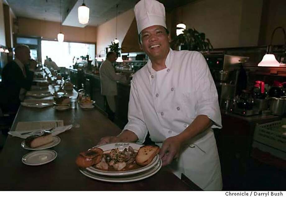.JPG  Chef Adriano Dela Rosa holds a plate of cioppino and sourdough bread he cooked at Tadich Grill in San Francisco, CA, on Wednesday, November, 15, 2006. 11/15/06  Darryl Bush / The Chronicle ** Adriano Dela Rosa (cq) MANDATORY CREDIT FOR PHOTOG AND SF CHRONICLE/ -MAGS OUT Photo: Darryl Bush