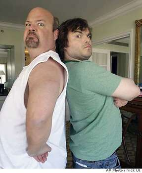 "Kyle Gass, left, and Jack Black pose for a photo in West Hollywood, Calif., on Friday, Oct. 27, 2006. Gass and Black are a rock duo who, with the help of a magical guitar, become ""the greatest rock gods of all time"" in the film ""Tenacious D in The Pick of Destiny."" (AP Photo/Nick Ut) Photo: NICK UT"