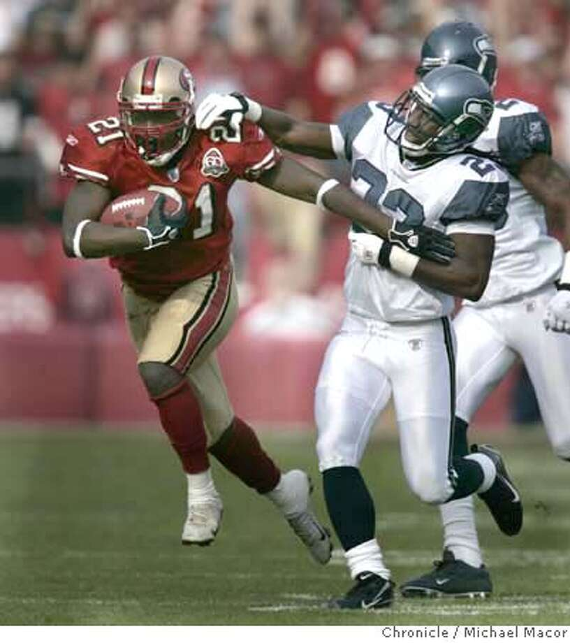 San Francisco 49ers running back Frank Gore (21) runs for long yardage as Seattle Seahawks cornerback Marcus Trufant (23) tries to bring him down in the first quarter. San Francisco 49ers play the Seattle Seahawks at Monster Park in San Francisco on Nov. 19, 2006.  Michael Macor / The Chronicle MANDATORY CREDIT FOR PHOTOG AND SF CHRONICLE/ -MAGS OUT Photo: Michael Macor