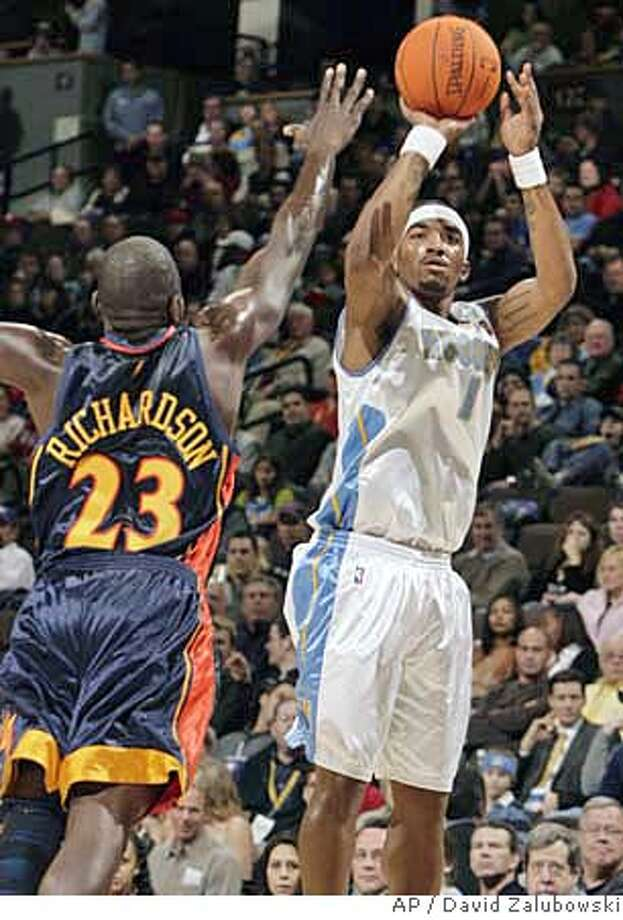Denver Nuggets guard J.R. Smith, right, goes up for a 3-point shot as Golden State Warriors guard Jason Richardson comes in to cover during the first quarter of an NBA basketball game in Denver on Friday, Nov. 24, 2006. (AP Photo/David Zalubowski) Photo: DAVID ZALUBOWSKI