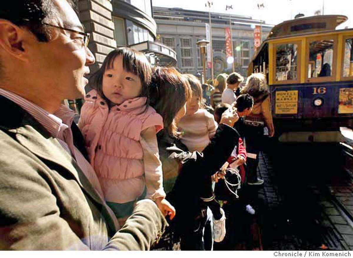 CABLECARS25_012_KK.JPG Masahiro Nagaoka of Los Angeles holds daughter Misaki, 2, as they wait for their turn on the Powell Street cable car. San Francisco is considering letting letting children ride the cable cars free on weekends and holidays. Photo by Kim Komenich/The Chronicle (**Masahiro Nagaoka) �2006, San Francisco Chronicle/Kim Komenich MANDATORY CREDIT FOR PHOTOG AND SAN FRANCISCO CHRONICLE/ -MAGS OUT
