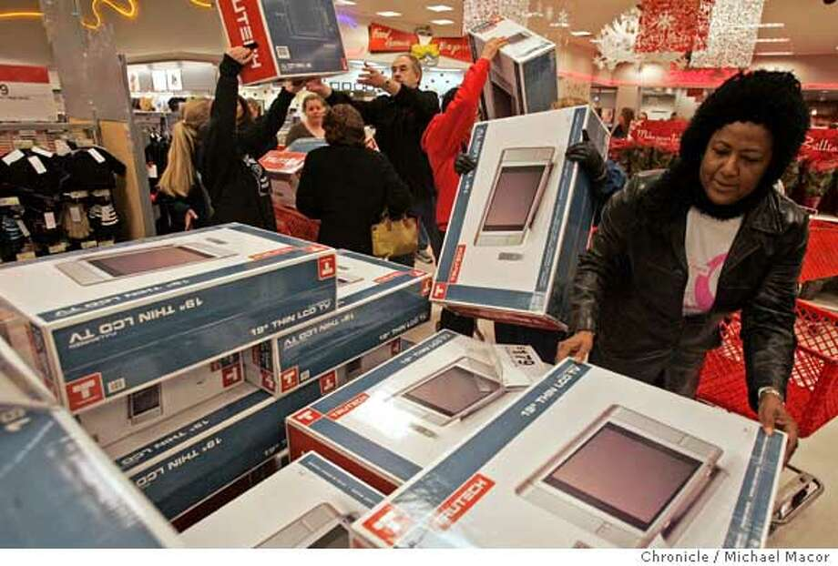 The display filled with flat screen TV's go fast as shoppers scramble for a unit. About 100 shoppers braved the cold morning to be first inside the Target store in downtown Walnut creek, searching for deals for the holidays. Event in, Walnut Creek, Ca, on 11/24/06. Photo by: Michael Macor/ San Francisco Chronicle Photo: Michael Macor