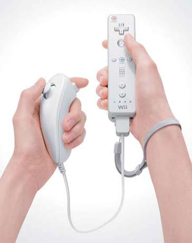 Nintendo Wii Remote (right)with Nunchuk attachment (left) Photo: Ho