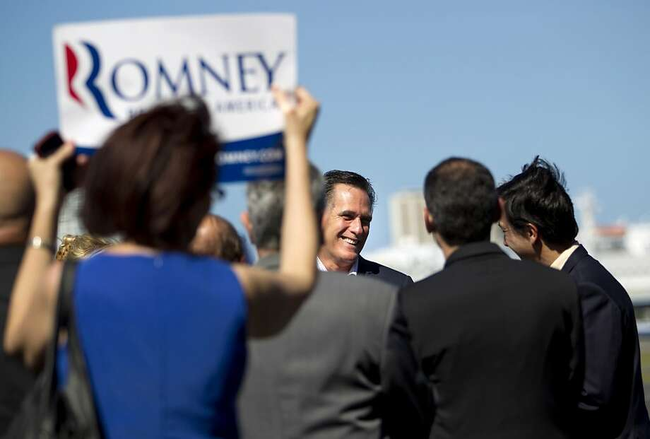 Republican presidential candidate, former Massachusetts Gov. Mitt Romney is greeted by supporters upon his arrival in San Juan, Puerto Rico, Friday, March 16, 2012. Photo: Evan Vucci, Associated Press