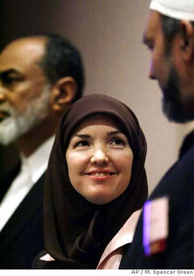 """Ingrid Mattson, newly elected president of the Islamic Society of North America smiles while talking to Fremont resident Mohamed Rajabally, a member of the ISNA executive committee during a press conference before at the opening of the 43rd annual ISNA convention Friday, Sept, 1, 2006 in Rosemont, Ill. The four-day convention will focus on a range of issues facing American Muslims and their evolving role and identity in the American society. Accompanying Mattson and Rajabally on stage is Abdul Malik Mujahid, chairman of the Council of Islamic Organizations of Grater Chicago. (AP Photo/M. Spencer Green)"" Photo: M. SPENCER GREEN"