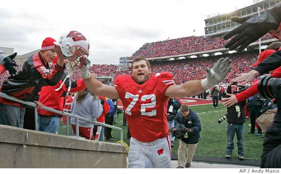 Wisconsin's Joe Thomas celebrates after a football game against Penn State Saturday, Nov. 4, 2006, in Madison, Wis. Wisconsin won 13-3. (AP Photo/Andy Manis) Photo: ANDY MANIS