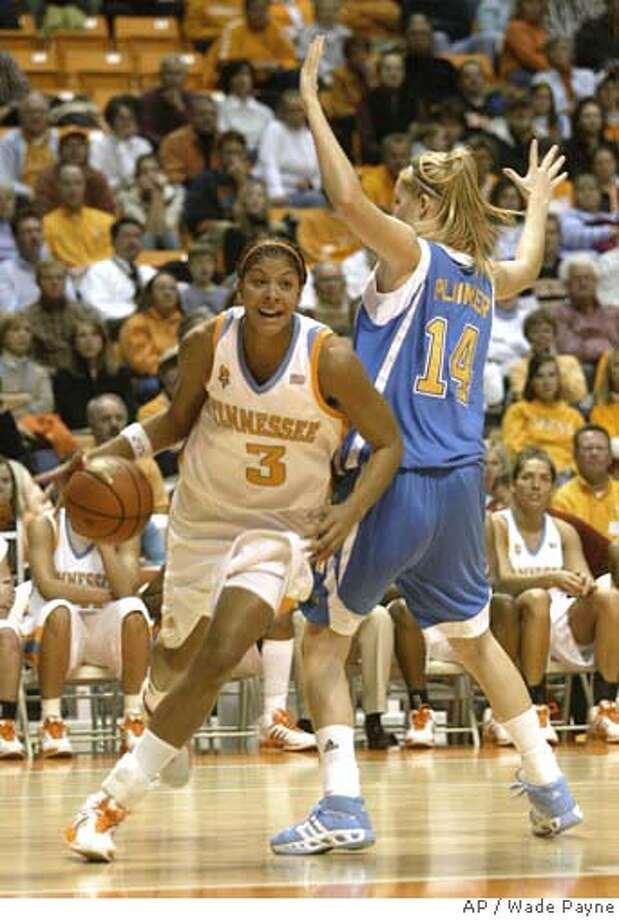 Tennessee's Candace Parker (3) drives against UCLA's Lindsey Pluimer (14) during their college basketball game Thursday, Nov. 16, 2006, in Knoxville, Tenn. Parker scored 22 points in the 83-60 win.(AP Photo/Wade Payne) Photo: WADE PAYNE