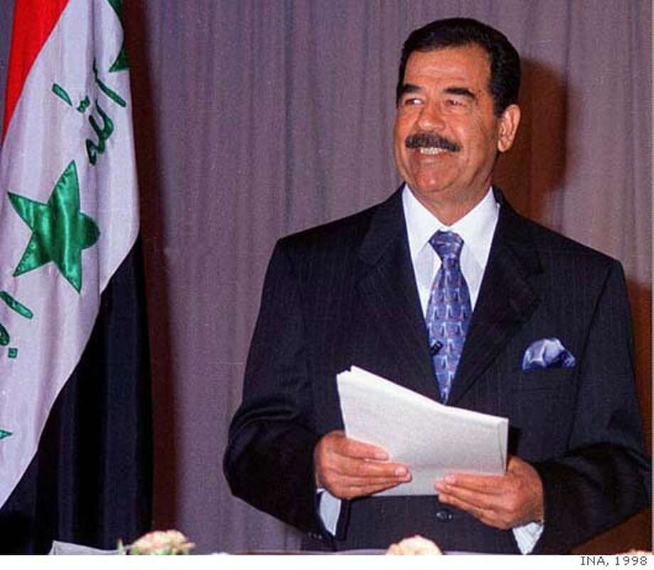 FILE--Iraqi President Saddam Hussein makes a speech in Baghdad, Iraq, in this July 17, 1998, file photo. Emboldened by success in Afghanistan, some U.S. lawmakers are beating the drum for quick action to get rid of Hussein. (AP Photo/INA, File) CAT A JULY 17, 1998 HANDOUT FILE PHOTO Photo: INA 1998