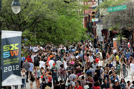 Crowds meander on 6th Street during South by Southwest on March 16, 2012, in Austin. Photo: EDWARD A. ORNELAS, Edward A. Ornelas/Express-News / © SAN ANTONIO EXPRESS-NEWS (NFS)