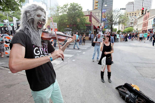 "The ""Violin Monster"" from Ann Arbor, MI,  performs on 6th Street during South by Southwest on March 16, 2012, in Austin. Photo: EDWARD A. ORNELAS, Edward A. Ornelas/Express-News / © SAN ANTONIO EXPRESS-NEWS (NFS)"