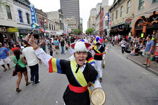 Rick Shin, 17, (center) leads the Korean percussion group Daool as they perform on 6th Street during South by Southwest on March 16, 2012, in Austin. Photo: EDWARD A. ORNELAS, Edward A. Ornelas/Express-News / © SAN ANTONIO EXPRESS-NEWS (NFS)