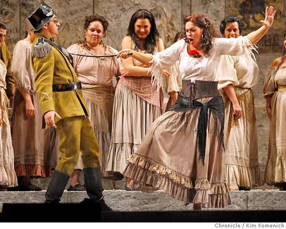 "CARMEN_025_KK.JPG The San Francisco Opera presents Bizet's ""Carmen."" Ricardo Herrera (L) as Zuniga; Hadar Halevy as Carmen. Photo by Kim Komenich/The Chronicle **Cast Sheet/Will Hamilton 565-6470 �2006, San Francisco Chronicle/Kim Komenich MANDATORY CREDIT FOR PHOTOG AND SAN FRANCISCO CHRONICLE/ -MAGS OUT"