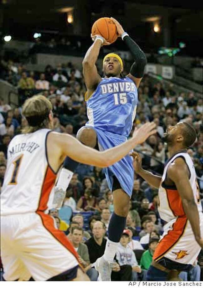 Denver Nuggets' Carmelo Anthony, middle, shoots over Golden State Warriors' Troy Murphy, left, and Baron Davis during the first half of an NBA basketball game in Oakland, Calif., Wednesday, Nov. 22, 2006. (AP Photo/Marcio Jose Sanchez) Photo: MARCIO JOSE SANCHEZ