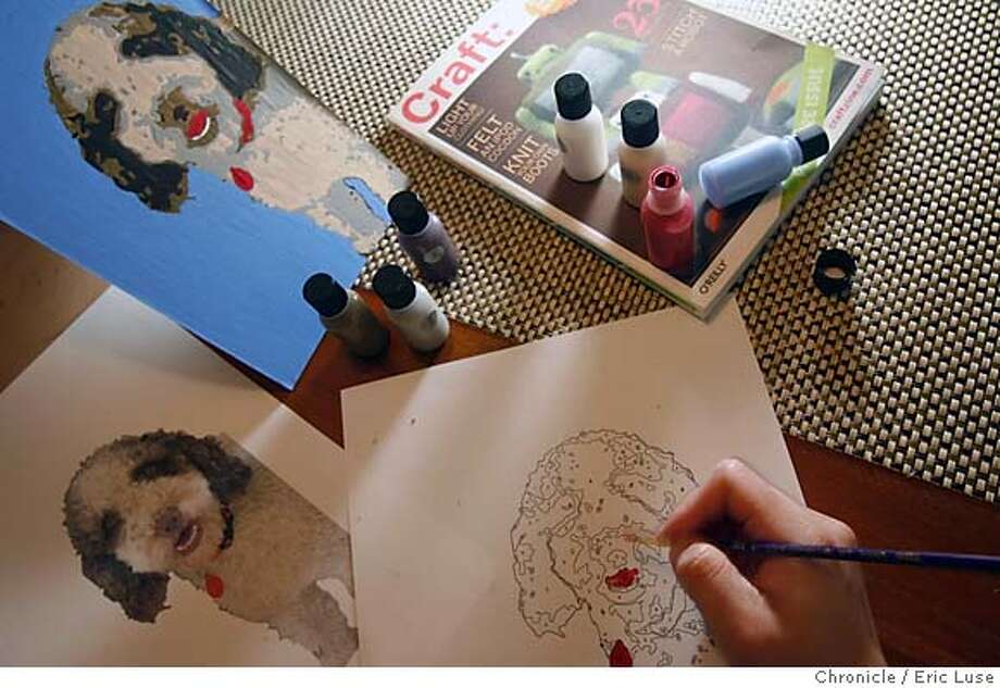 crafts_066_el.JPG  Le paints on Paint by Numbers which uses photoshop to enable a drawing from a photo which allows a numbering system to then paint as scene in the background of a family dog named Dulce.  Anh-Minh Le working on ideas from Craft magazine.  Photographer:  Eric Luse / The Chronicle names cq with source MANDATORY CREDIT FOR PHOTOG AND SF CHRONICLE/ -MAGS OUT Photo: Eric Luse