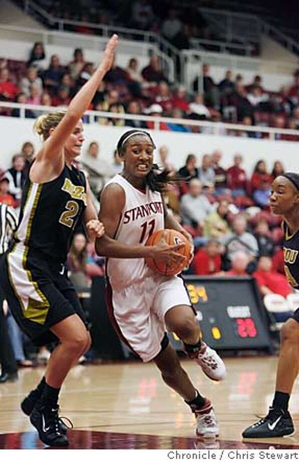 stanford_0135_cs.jpg  Stanford's Candice Wiggins (11) drives past Missouri defender Kassie Drew (22) in the first period as the Stanford University Cardinals women's basketball host the University of Missouri Tigers at Maples Pavilion November 21, 2006. At half time Stanford led 39-22.  Chris Stewart / The Chronicle Stanford University women's basketball Photo: Chris Stewart