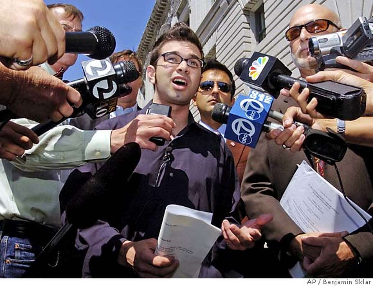 ** FILE ** Josh Wolf speaks to the press in this file photo taken Friday, Sept. 1, 2006, in San Francisco. Wolf's attorneys will ask a federal judge on Tuesday, Nov. 21, 2006, to release him from jail for refusing to testify before a federal grand jury regarding unpublished footage he won't divulge of an anarchist protest in San Francisco. (AP Photo/Benjamin Sklar) SEPT. 1, 2006 FILE PHOTO