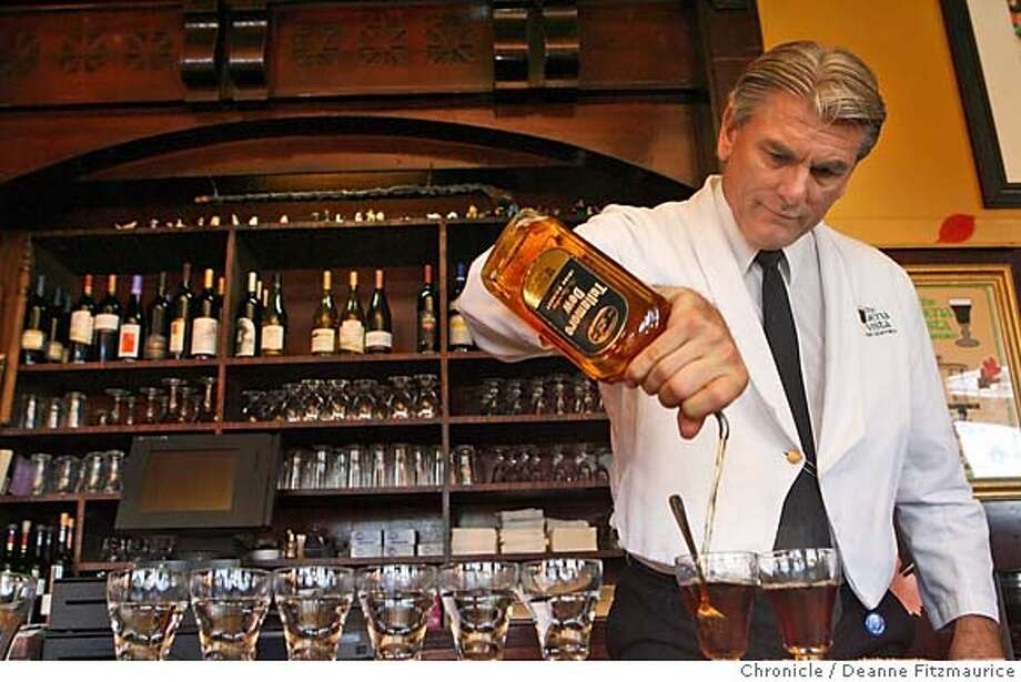 irish_0068_df.jpg  The Buena Vista is now serving Tullamore Dew whisky in their famous Irish Coffees. Bartender Paul Nolan works on preparing an irish coffee. Photographed in San Francisco on 11/21/06. (Deanne Fitzmaurice/ The Chronicle) Mandatory credit for photographer and San Francisco Chronicle. /Magazines out. Photo: Deanne Fitzmaurice