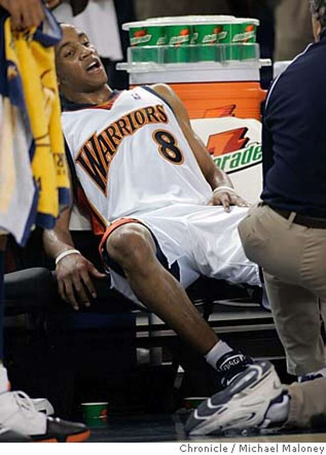 Warriors Monta Ellis (8) sits on the bench exhausted in the closing seconds of the game with an injured knee.  Golden State Warriors vs the Phoenix Suns at Oracle Arena.  Photo by Michael Maloney / San Francisco Chronicle on 11/20/06 in Oakland,CA Photo: Michael Maloney
